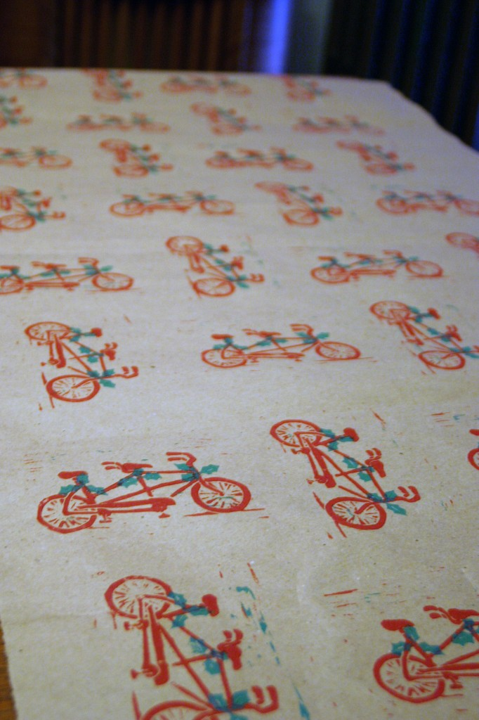 And then, because I was on a printing rampage, I decided to make myself some tandem bicycle wrapping paper.  Hmm….I wonder what lucky recipient is going to get a gift wrapped in this?  So that's what I've been doing so far this holiday season.  Now I have to get to work on my own Christmas cards.  Plus there's that blasted illustration to finish for December.  And then I have a few more crafty holiday projects in the works.  If you do happen to wander over to Etsy, you might want to check out a couple of the other things up there.  Perhaps someone you know desperately needs a tea light candle holder made from reclaimed wood timbers.  Or maybe you're in the market for a necklace made from reclaimed thread-wrapped beads and ribbon.  I'm telling you, it's a bucket of random over there.  You never know what you might find.  And who knows what else will be up there by the time I'm through with my holiday crafting spree!